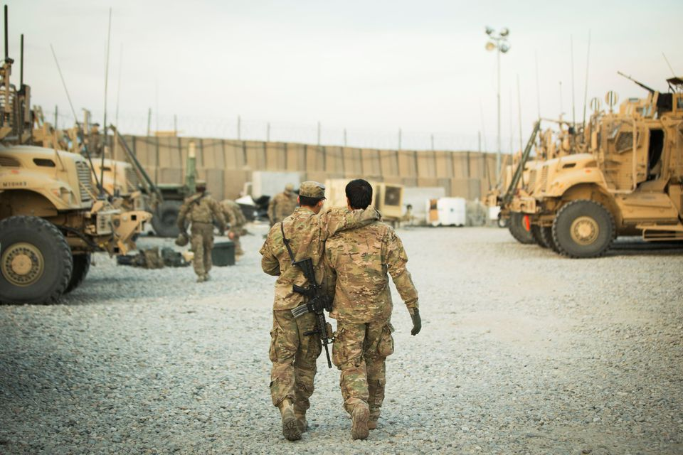 A U.S. soldier from the 3rd Cavalry Regiment walks with the unit's Afghan interpreter before a mission near forward operating base Gamberi in the Laghman province of Afghanistan December 11, 2014. REUTERS/Lucas Jackson/File Photo